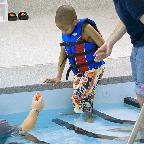 Monarch student with autism doing therapeutic adaptive swimming